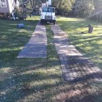 Lawn being protected so trucks can drive without damaging lawn
